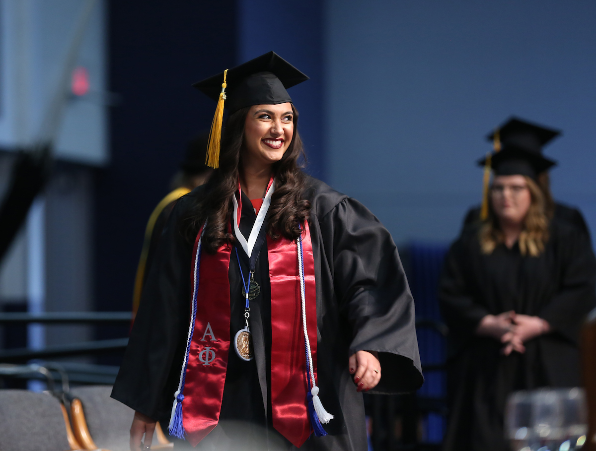 Asha Bahr, rehabilitation services graduate, crossing the stage at commencement, May 2018.
