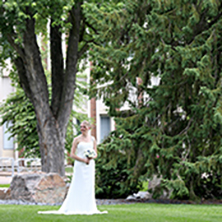 A bride standing in the Arboretum at UW-Stout.