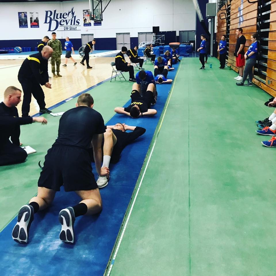 ROTC fitness training. Students doing sit-ups.