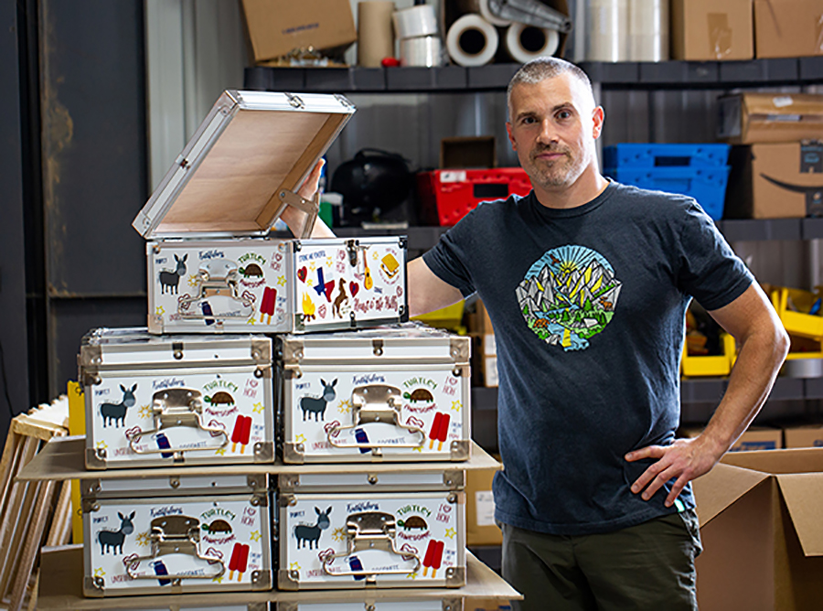 Mark Sieglaff, C&N vice president, inspects an order of custom minitrunks for Heart O' the Hills Camp in Hunt, Texas.