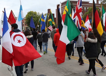 Photo of International Students in parade with flags