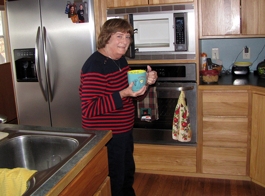 Lynn LaVenture makes a cup of tea at her Menomonie home. She is one of nearly 100,000 people on a kidney transplant waiting list.