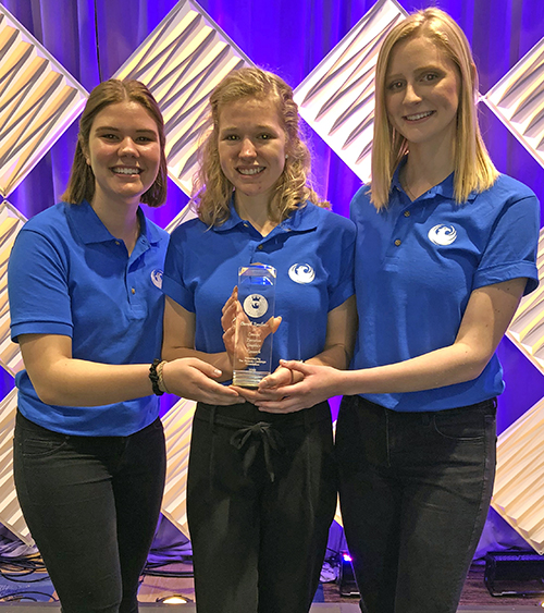Team members left to right, Mia Bartel, Abbegail Lee and Bridget Johnson after receiving the Phoenix Challenge Competition award  in New Orleans