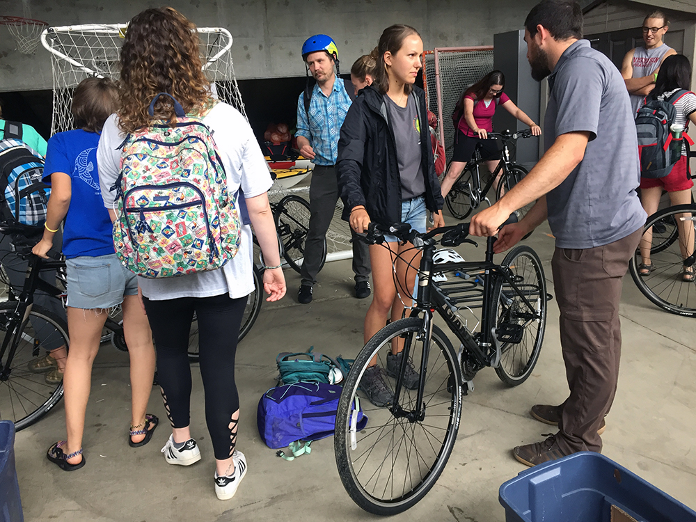 Houston Taylor, Stout Adventures, at right, explains the fit of a bike to LAKES REU student Kirsten Ondris, of Vernon, N.J.
