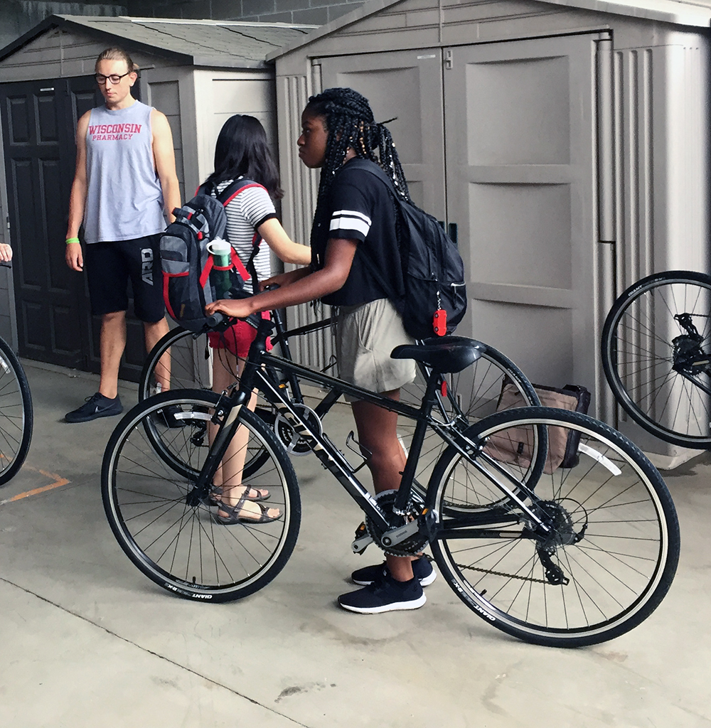 LAKES REU student Zayyan Swaby, of Stony Brook University, New York, checks out the fit of a bicycle from StoutBikes