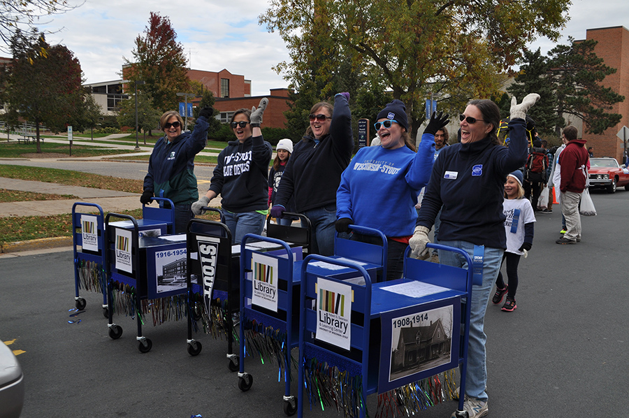 Vogl, at right, with the University Library drill cart team during Homecoming 2016.