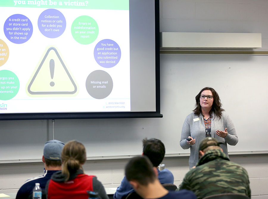 Chelse Cockeram, of WESTconsin Credit Union, presents information about identity theft and fraud to students in a Financial Wellness class.
