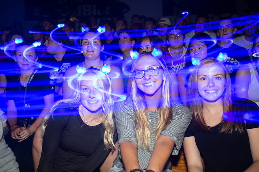Blue Devil horns of light swirl around students Sept. 1 during the Blue Rah celebration at UW-Stout to welcome first-year students to campus. Enrollment for first-year students is up 6.7% this fall.
