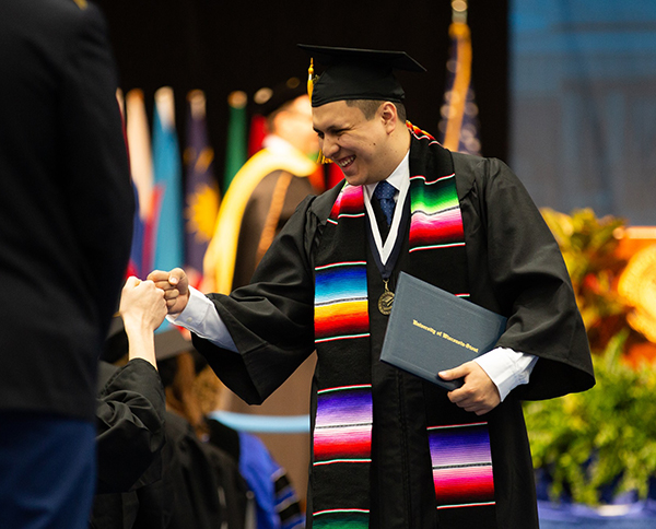 Students celebrate during commencement ceremonies Saturday, May 4.