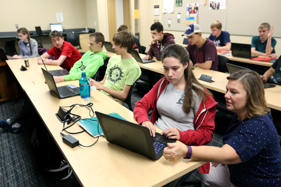 Professor Diane Christie, right, helps students in a Computer Science I class in September at UW-Stout, which has been named a national Center of Academic Excellence in Cyber Defense.