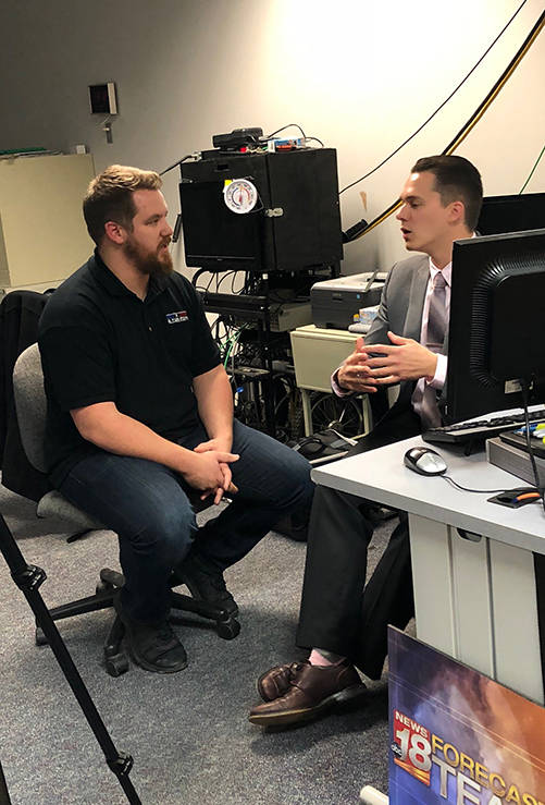 "Domanick Bainey, left, interviews WQOW TV 18 meteorologist Justin Esterly for a segment of ""Exploring America."""