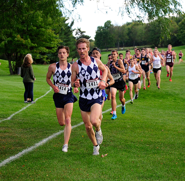 Mike Friedman leads a pack of runners during a cross country meet. Friedman will be a senior this fall.