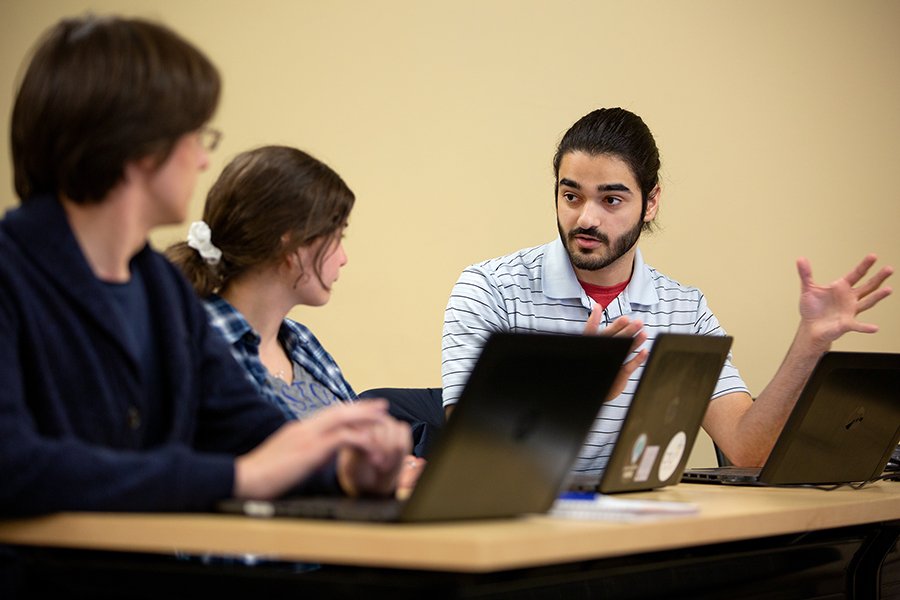 From left, students d'Artagnan Kramer, Natalie Bruns and David Amirahmadi discuss an issue in the class.