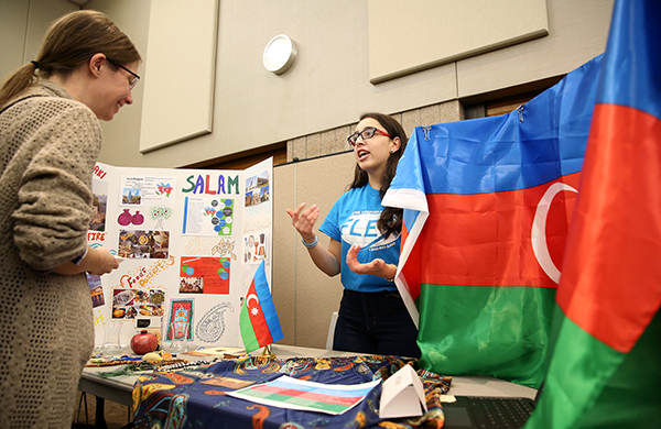 ​​​​​​​A student talks about her country during the international exhibits in 2018.