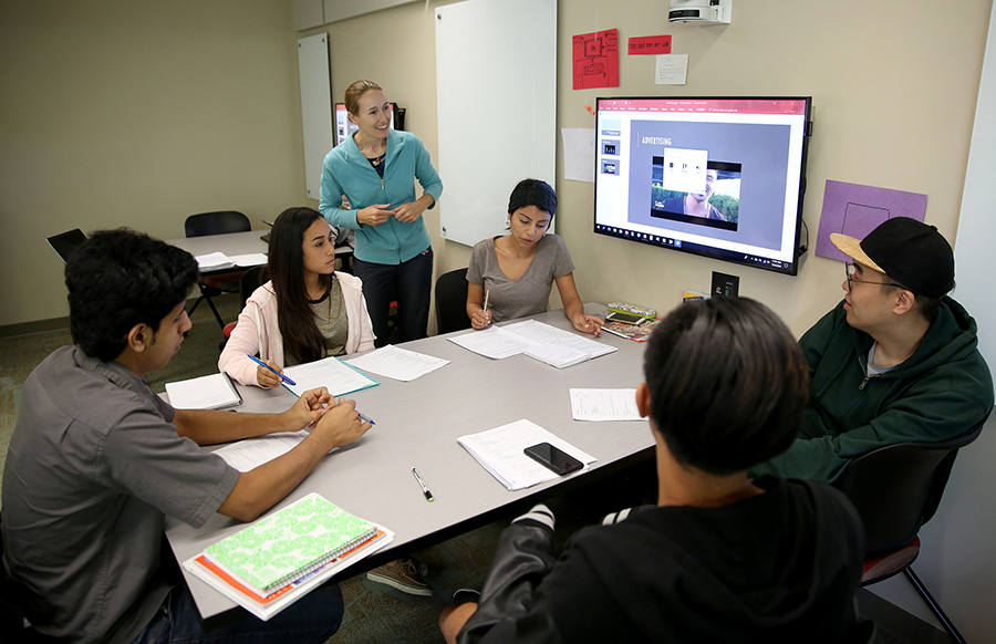Instructor Pamela Onchuck works with students at UW-Stout's English as a Second Language Institute. Second from left is Gladymar Betancourt of Puerto Rico.