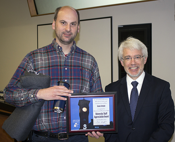 Jason Jenson, left, received the University Staff Employee Appreciation Award for December at UW-Stout from interim Chancellor Patrick Guilfoile.