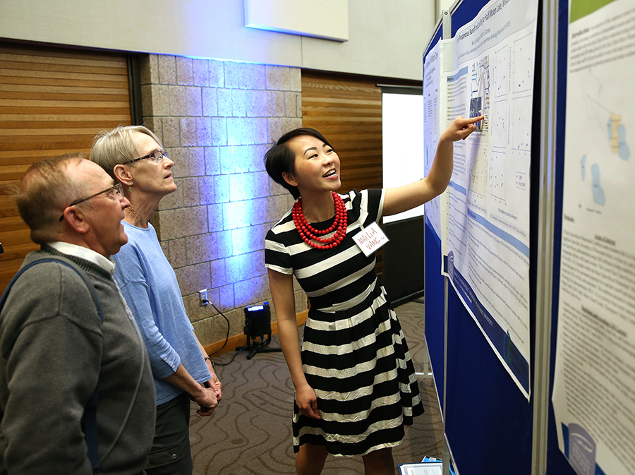 Mailia Vang talks about her research project during Research Day in 2018.