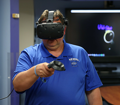 Kevin W. Tharp uses a virtual reality headset.