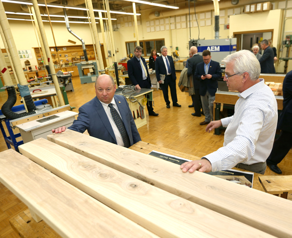 Ashley Furniture president and CEO Todd Wanek, left, tours the woods lab in Jarvis Hall Technology Wing with Professor Jerry Johnson Thursday, Oct. 26, during the Cabot Executive in Residence program.