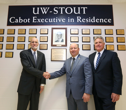 From left, Scott Cabot, Todd Wanek and Chancellor Bob Meyer gather at the Cabot Executive in Residence Wall of Honor at UW-Stout.