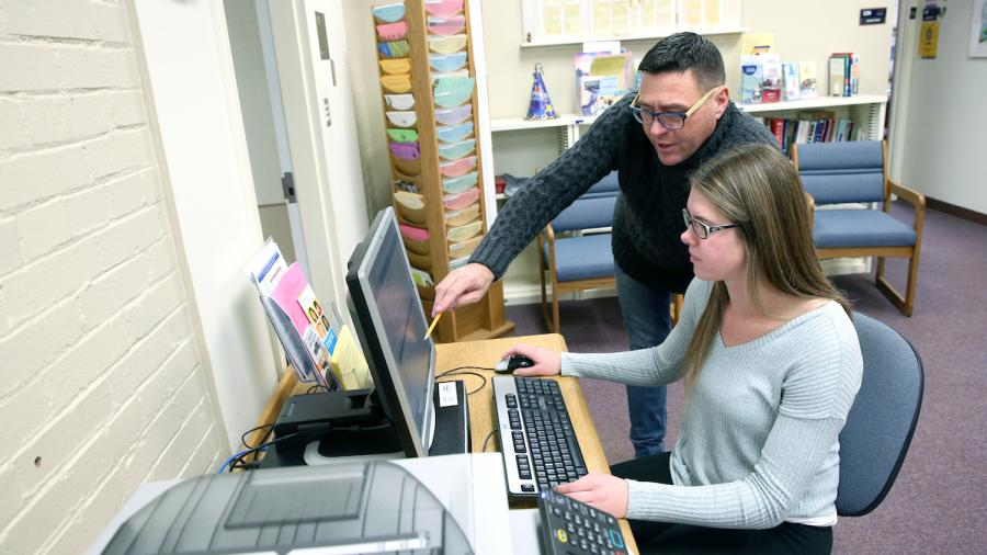 Advisor Jamie Arenz works with a student at the Advisement Center Tuesday, December 12, 2017.
