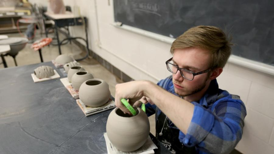 A student works in the ceramics lab in Applied Arts.