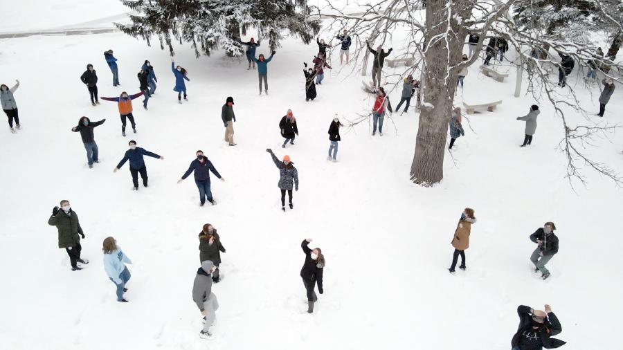 The choir disperses in the snow for the video.