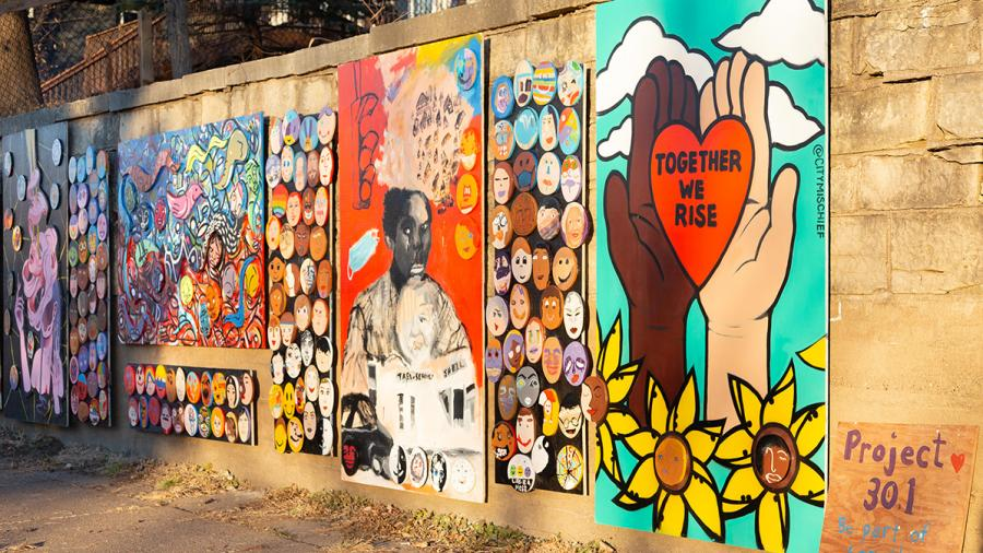 The mural contains artwork from artists to remember George Floyd and raise awareness about social injustice and racial inequalities