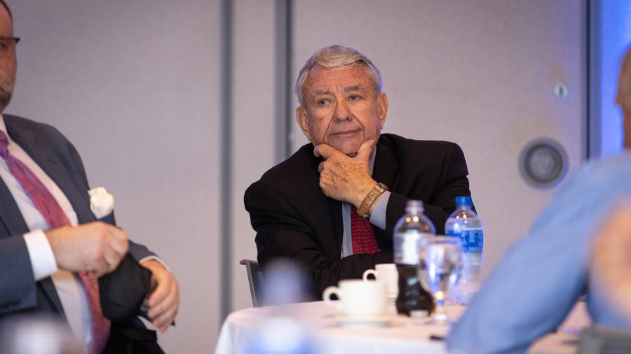 Tommy Thompson listens Monday while meeting during lunch with community officials.