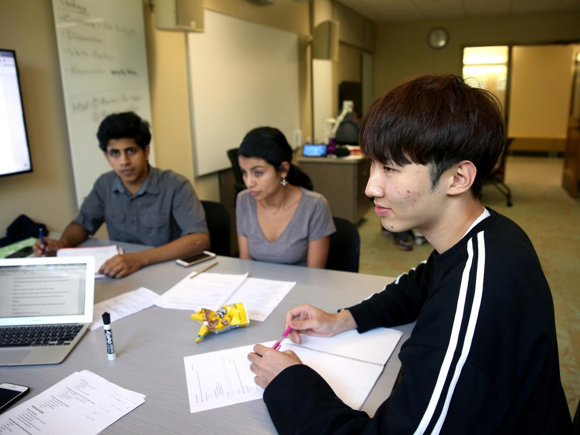 Minje Kwon, right, from Seoul, South Korea, attends an English as a second language class this summer.