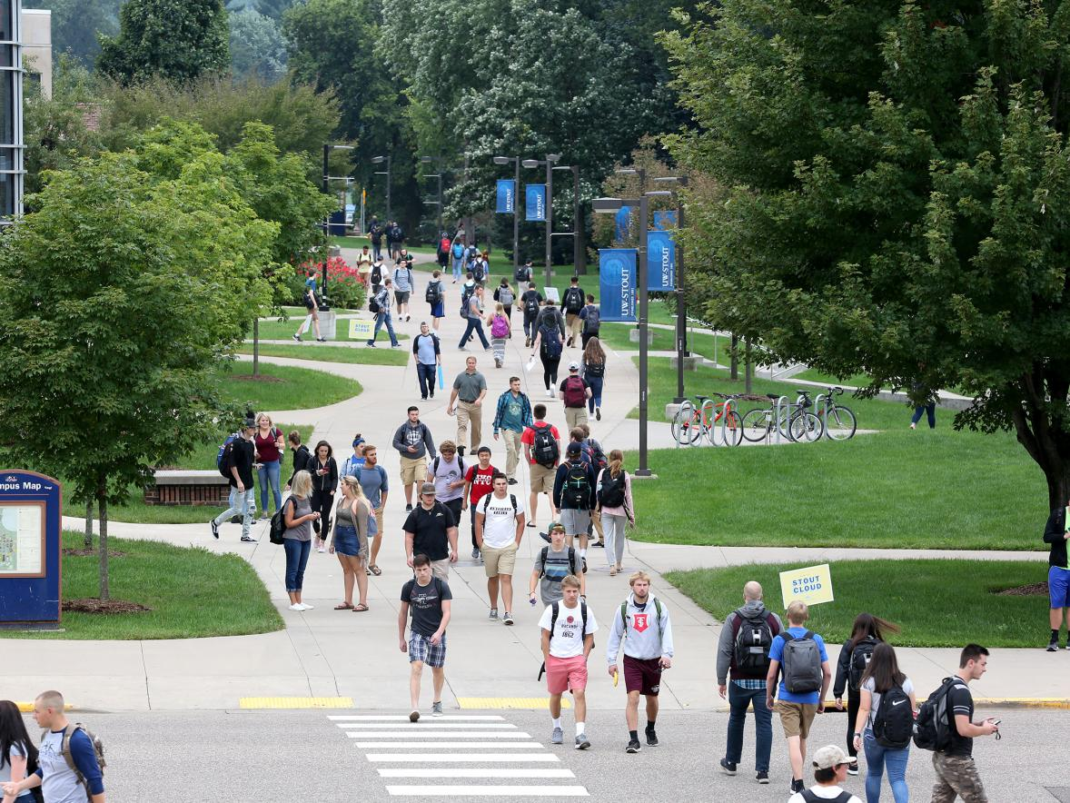 Students cross the campus mall Wednesday, Sept. 5, during the first day of fall semester classes.