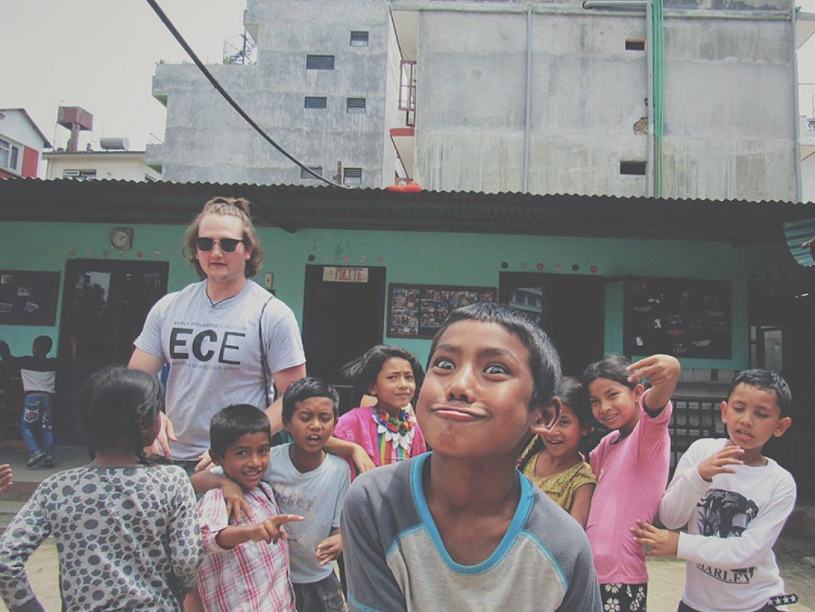 Dylan Lubs, pictured in a playground area with students, visited Nepal and taught there for a month.