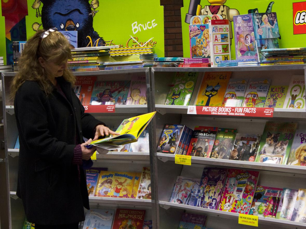 A customer browses at a recent Scholastic book fair at UW-Stout. A student chapter of Aspiring Educators of Wisconsin will host a similar book fair Nov. 27-30.