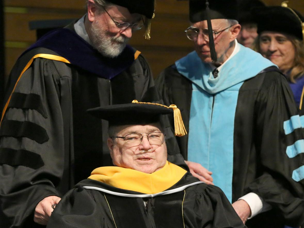 Larry Schneider receives an honorary Doctor of Science degree.
