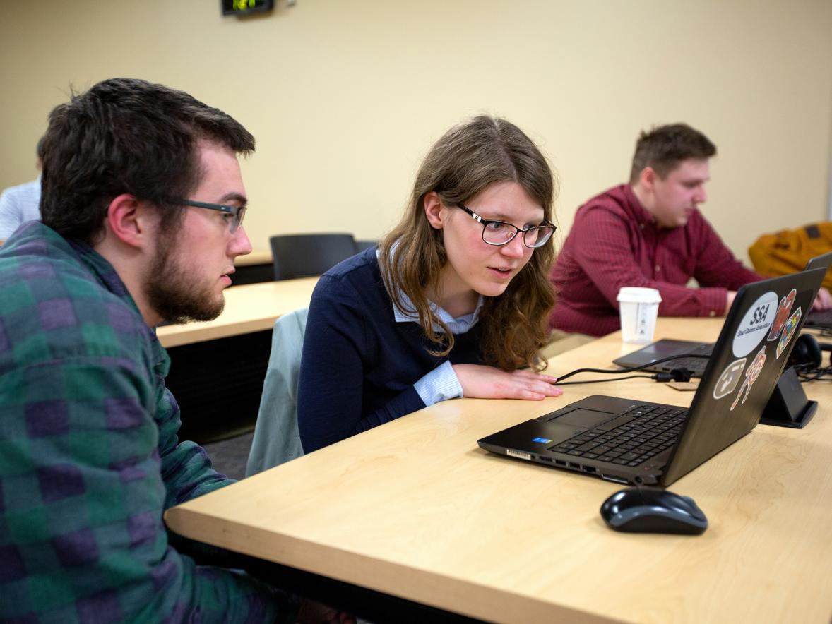 Student Erica Kelly goes over a problem with Assistant Professor Tyler Skorczewski in the Industrial Math class.