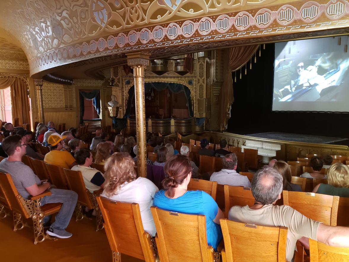 Red Cedar Film Festival attendees watch a festival film at the Mabel Tainter Center for the Arts in Menomonie.