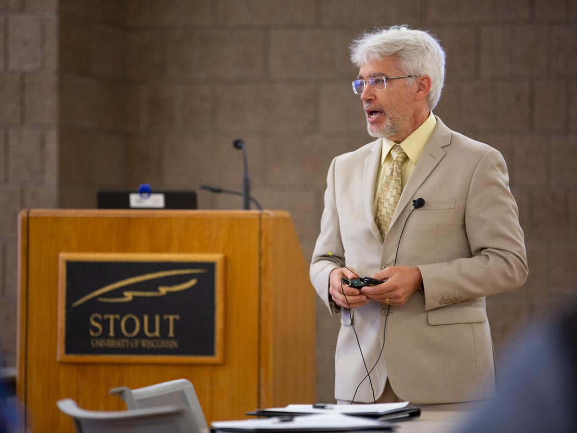 Patrick Guilfoile addresses new faculty and instructors Monday, Aug. 19, his first day as interim chancellor at UW-Stout.