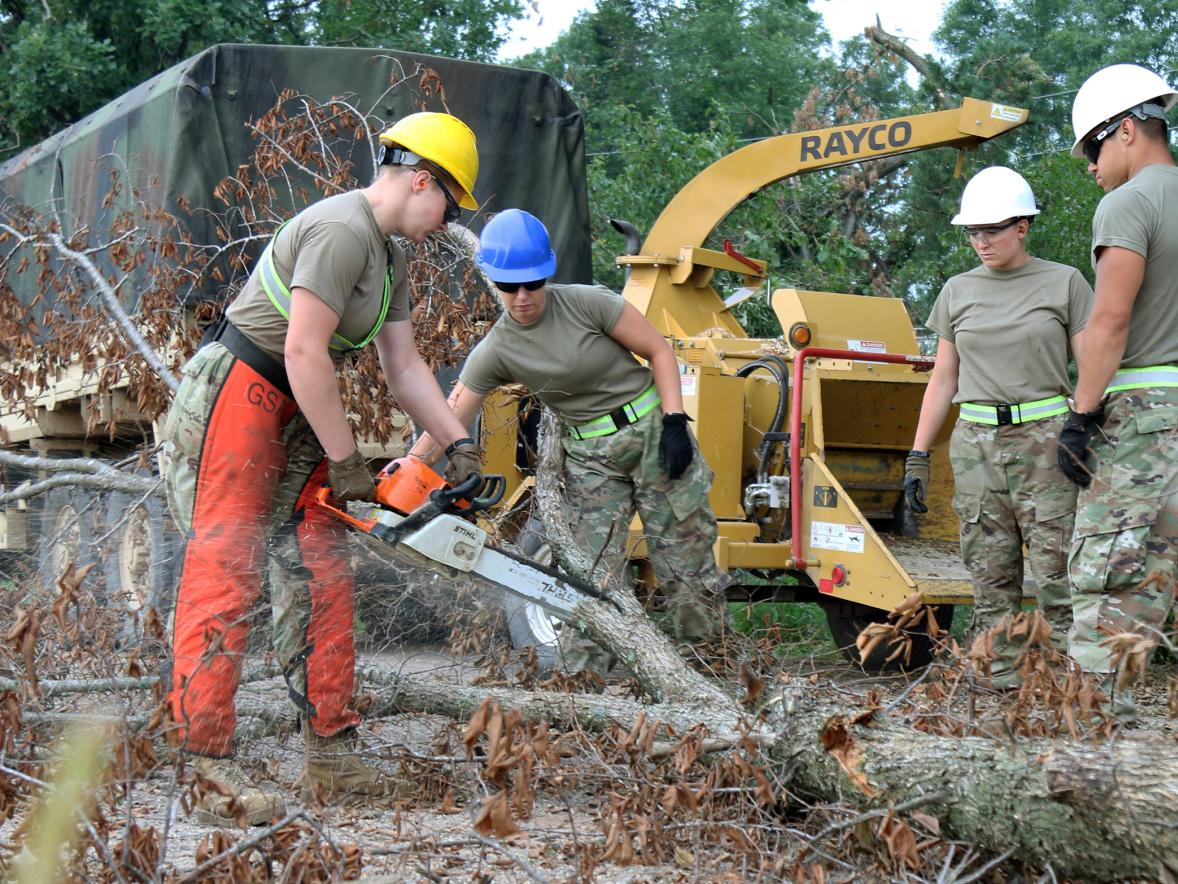 Alysha Stieber, second from left, helps with storm cleanup this summer in northern Wisconsin as part of the Wisconsin National Guard.