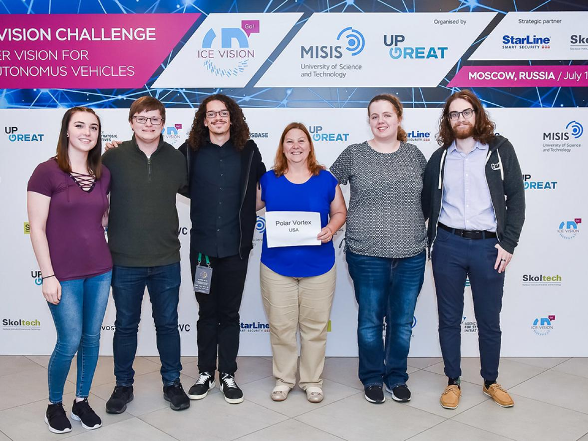 UW-Stout Ice Vision Hackathon team student members Megan Southwick, at left, Kyle Lunde, Jonathon Terry, Professor Diane Christie, Christina Miller and Simon Meyer pose for a picture at the competition held in Moscow. The team won a best presentation award. / Photos courtesy of MiSiS