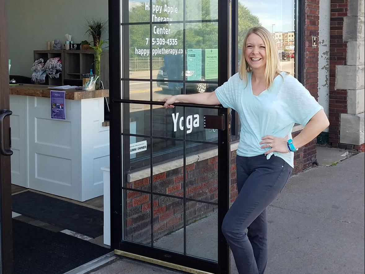 Photo of Rachel Funk-Johnson in front of Happy Apple Therapy Center