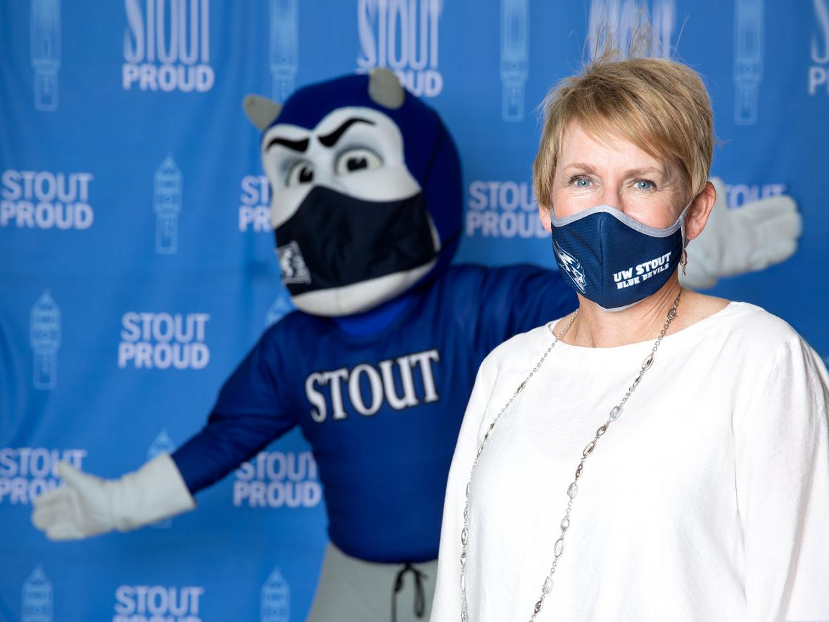 Photo of Chancellor Katherine P. Frank and Blaze wearing masks.