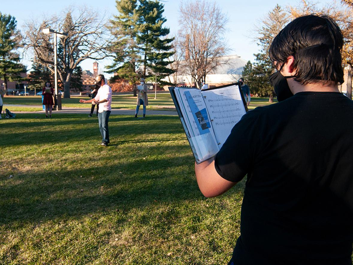UW-Stout's Symphonic Singers practice outside on campus with social distancing to prevent the spread of COVID-19.