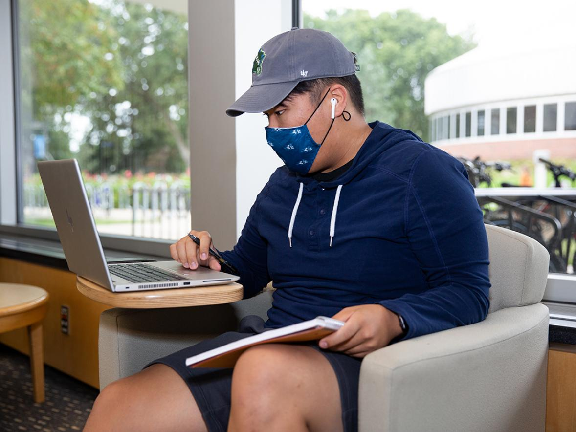 A student studying on campus.