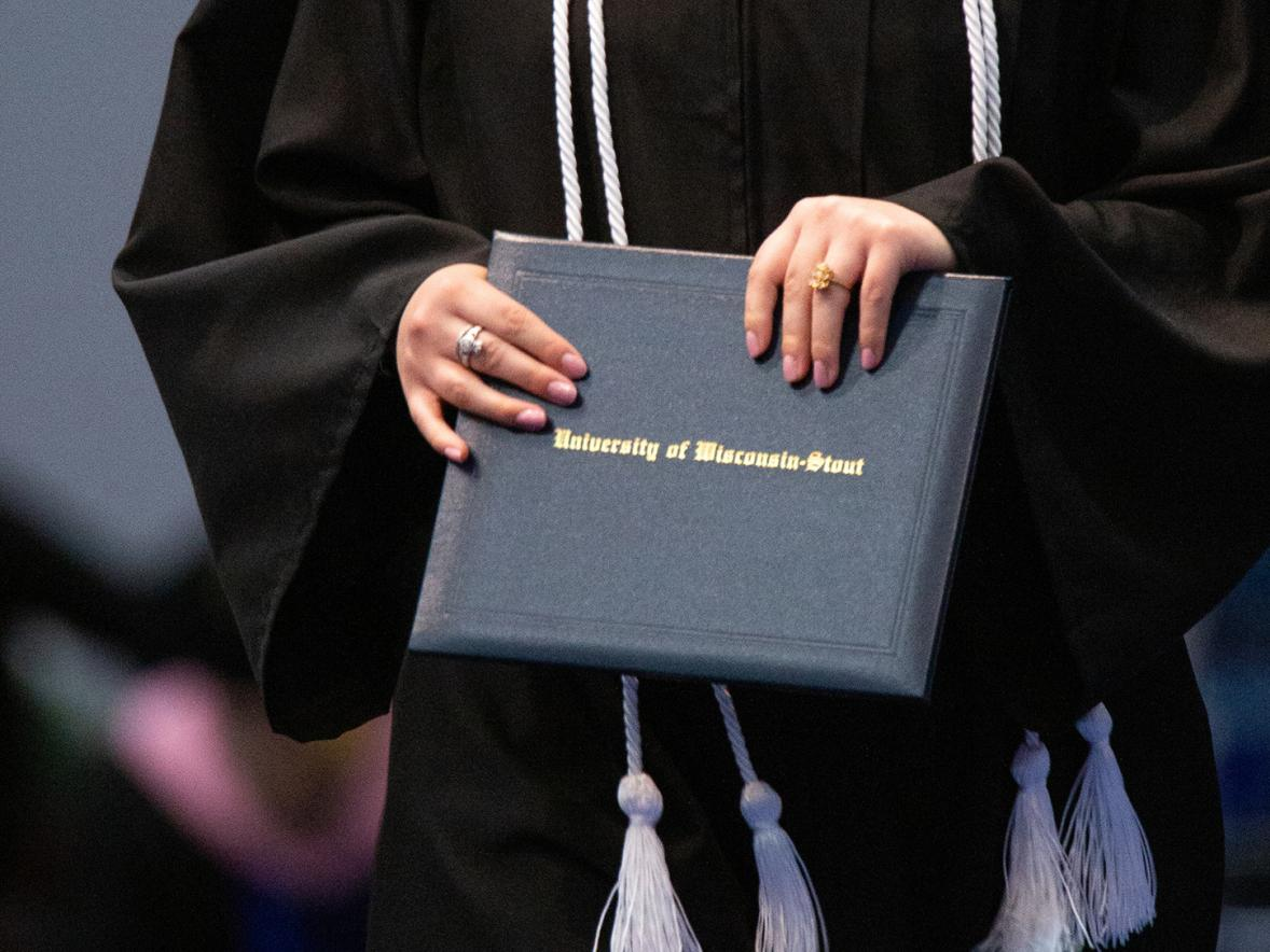 A graduate clutches her diploma at a recent commencement.