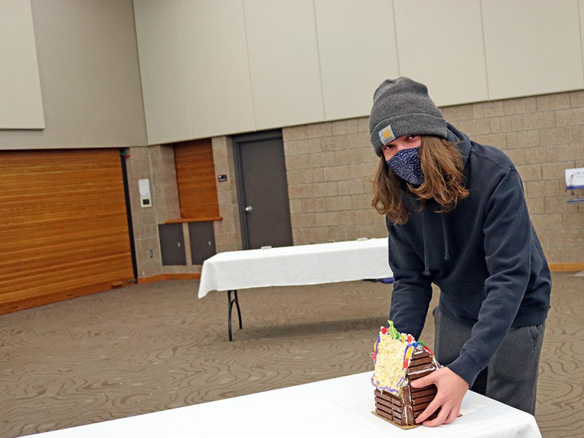 UW-Stout student Ross Barnett used Kit Kat candy bars on his gingerbread house to make it look like a log cabin.