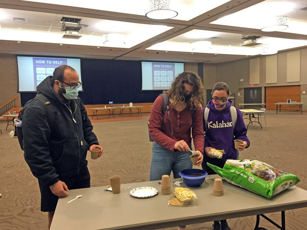 UW-Stout students Michael Wilson, at left, Amara Miller and Tori Williams plant flower seeds during the Self-Care is Everywhere event at UW-Stout. The Counseling Center and Student Life Services are holding events to help student cope with stress. /UW-Stout photo