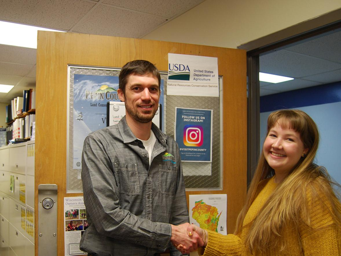 UW-Stout student Molli Reeder, at right, met last year prior to COVID-19 with Chase Cummings, Pepin County Land Conservation planning director.