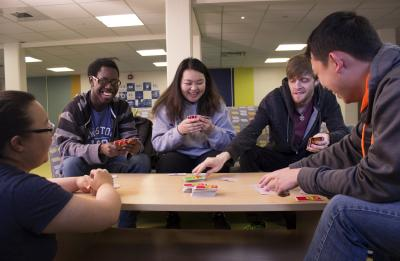 Students playing Uno, the card game