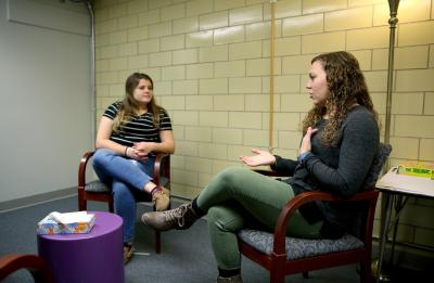 Students perform one-on-one counseling sessions in the Counseling Lab on campus.