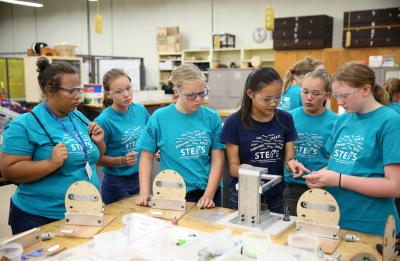 The annual STEPS for Girls camp is photographed Tuesday, July 17, 2018. Pictured is lab assistant Amber Knudson (third from right) assisting campers with the assembly of robots in a lab in Jarvis Hall Technology Wing, where participants experienced and learned about key manufacturing concepts and processes . (UW-Stout photo by Brett T. Roseman)